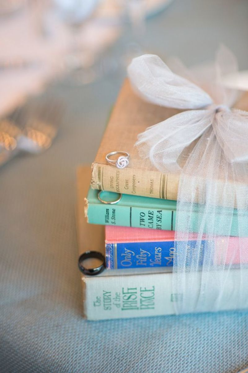 Stack of books and diamond rings