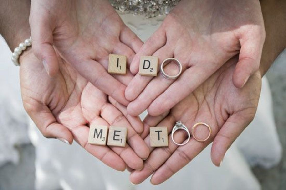 """I do"" with a diamond ring and wedding rings"