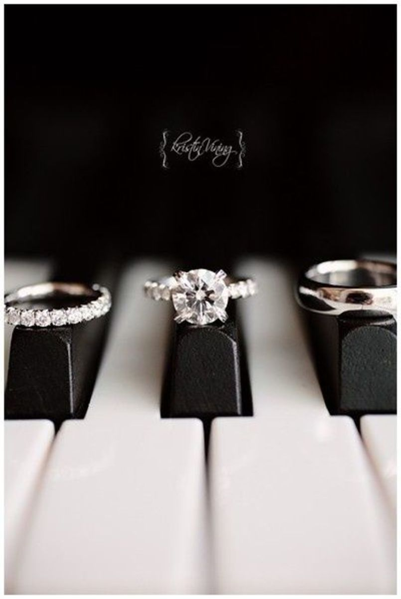 Classic picture of Wedding rings on Piano keys
