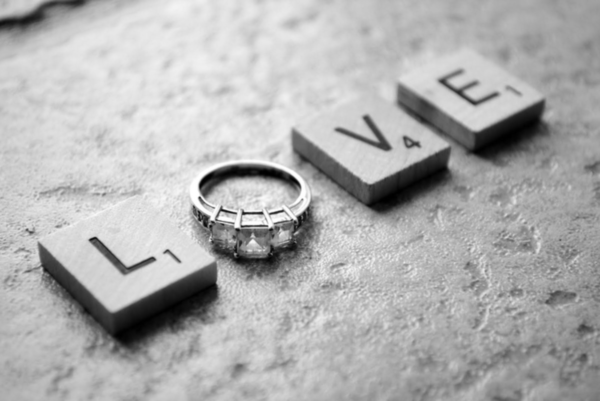 Black and white photography of LOVE with a diamond engagement ring