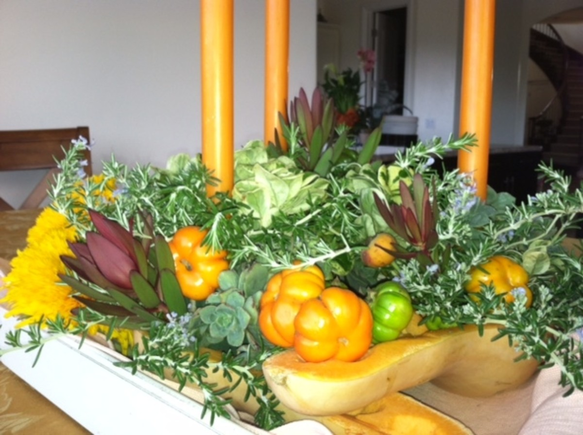 This Thanksgiving centerpiece features seasonal gourds and succulents. Look closely to discover the use of succulents as fillers. They provide a vibrant pop of color. Rosemary (also considered drought-resistant) makes a good filler too.