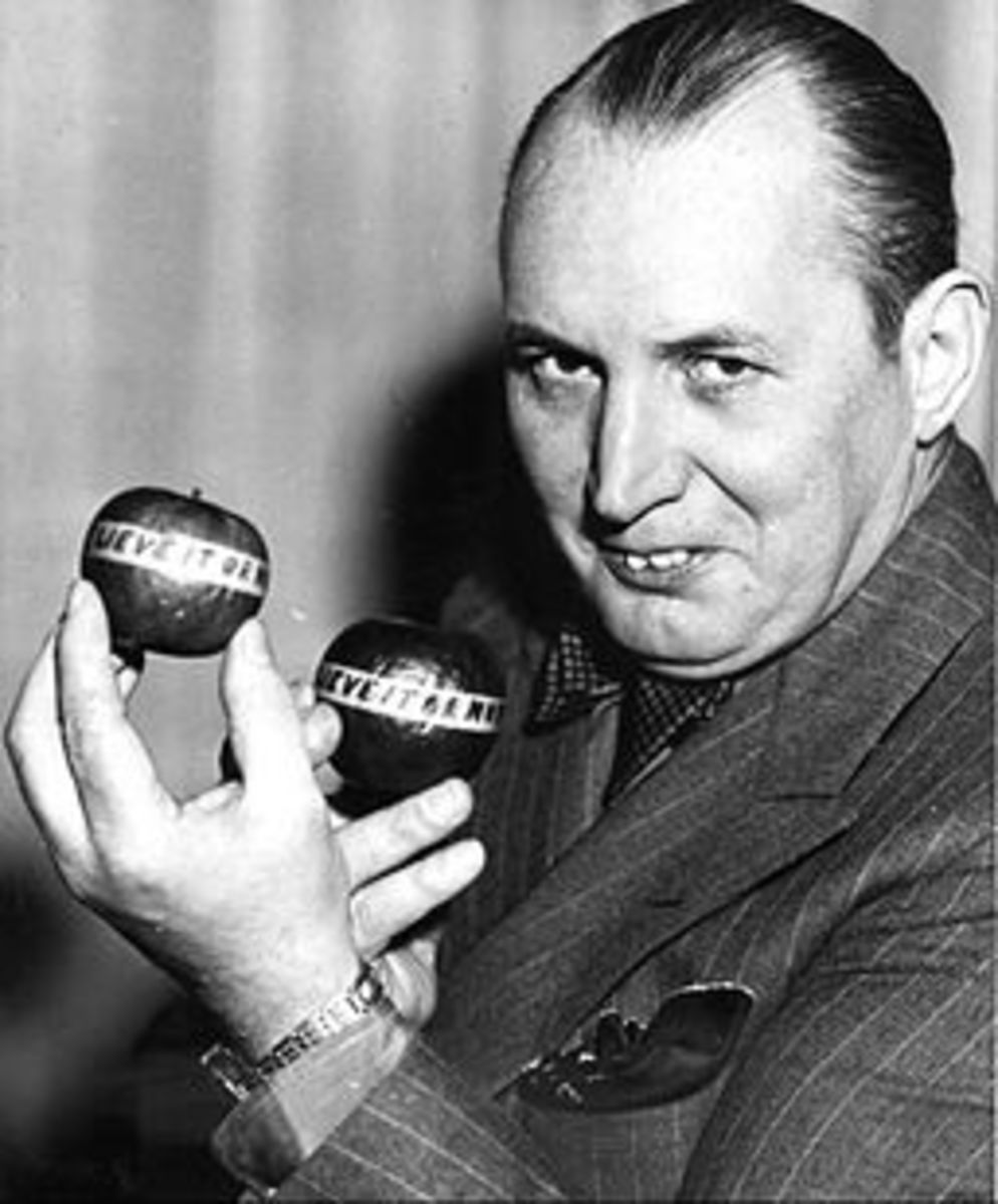 "Robert Ripley holding ""Believe It Or Not"" apples."