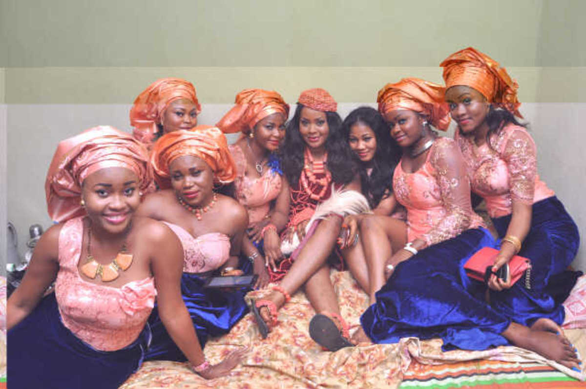 Igbo traditional wedding guests often wear the same color code.