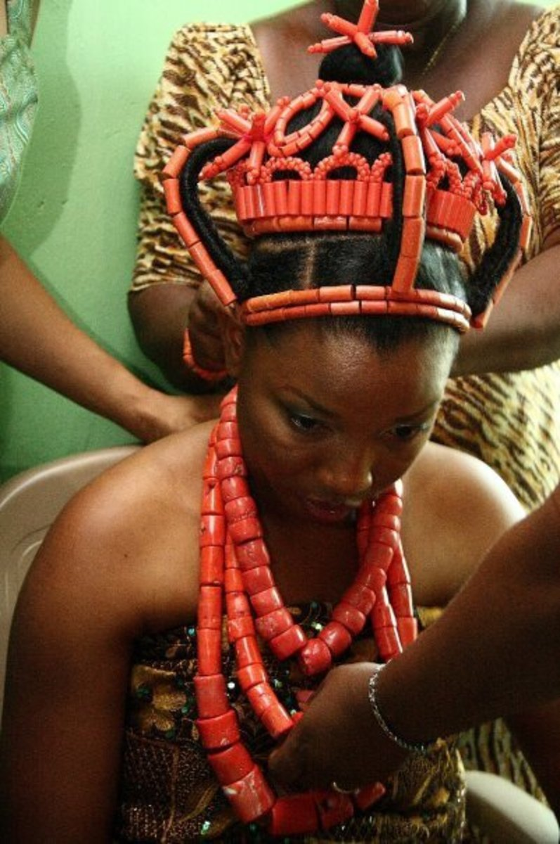 Traditional coral beads on a bride.