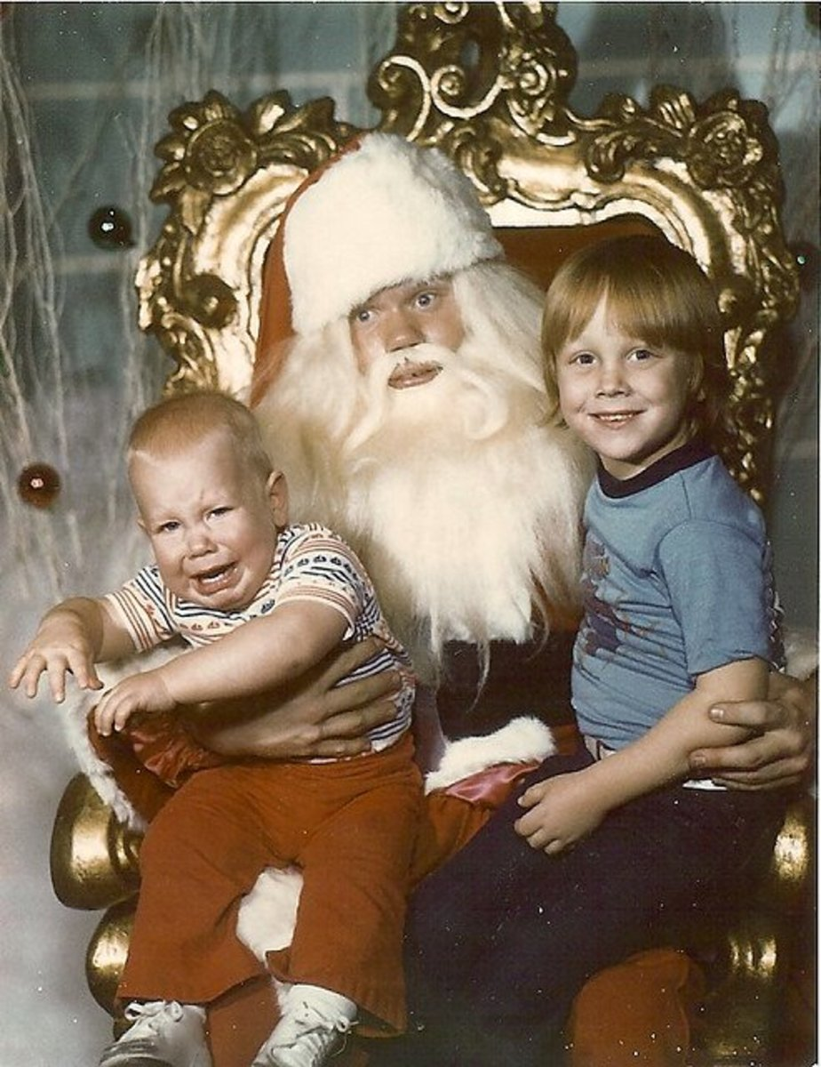 What a priceless expression on Santa's face!  And look at the older brother who is enjoying the whole experience!