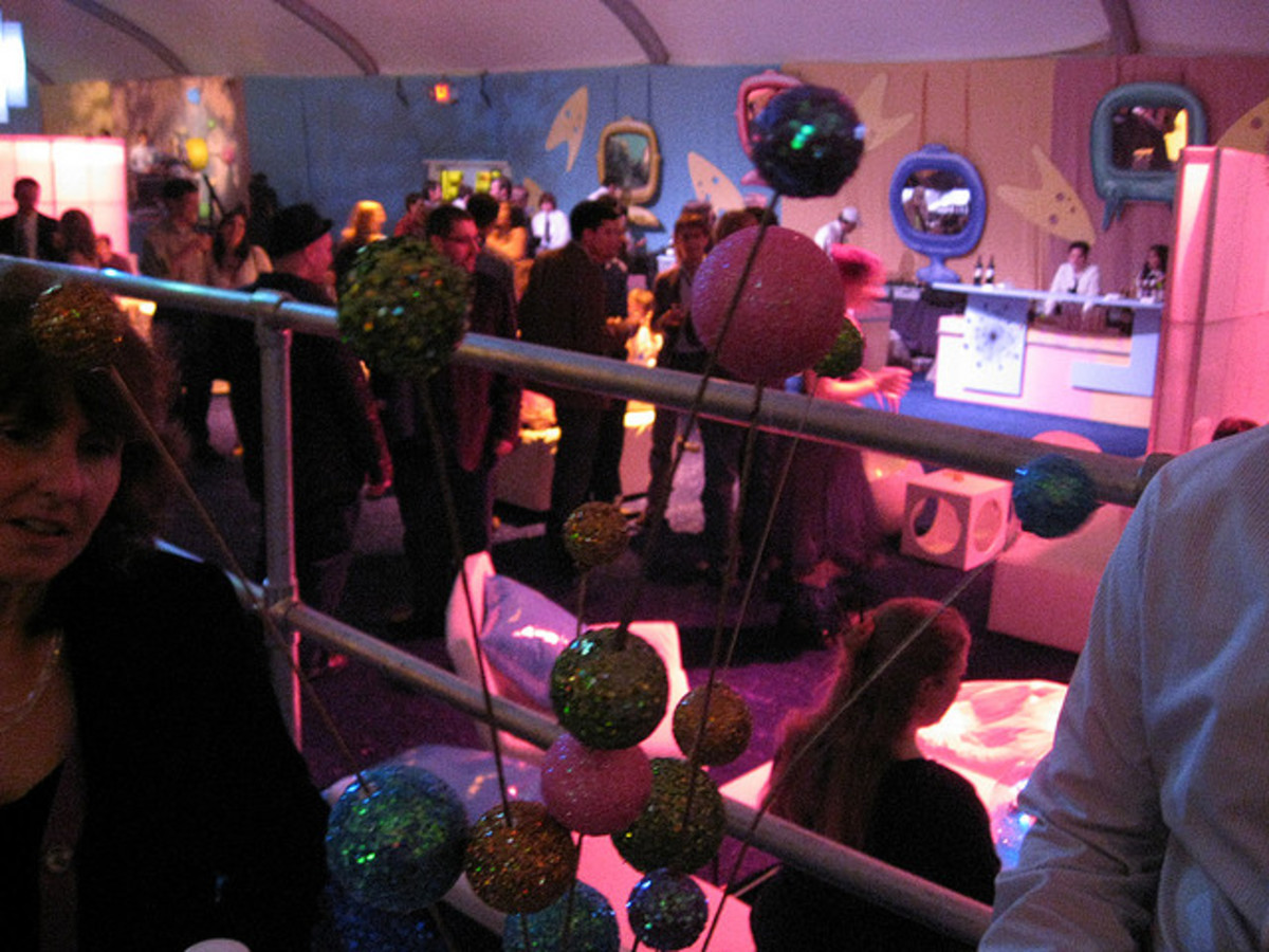 Use smaller sparkly Styrofoam balls as planets for table décor or hang from the ceiling/rafters!