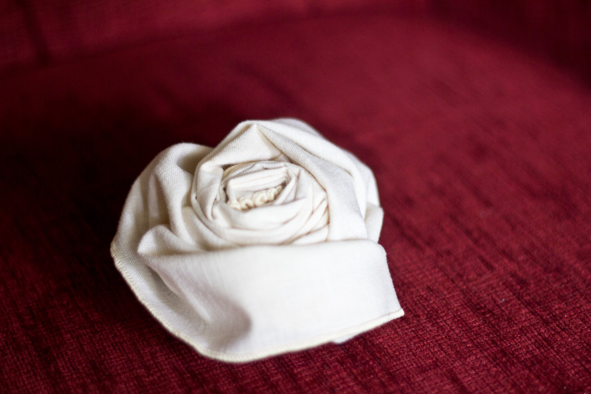 A rose folded out of a cloth napkin.