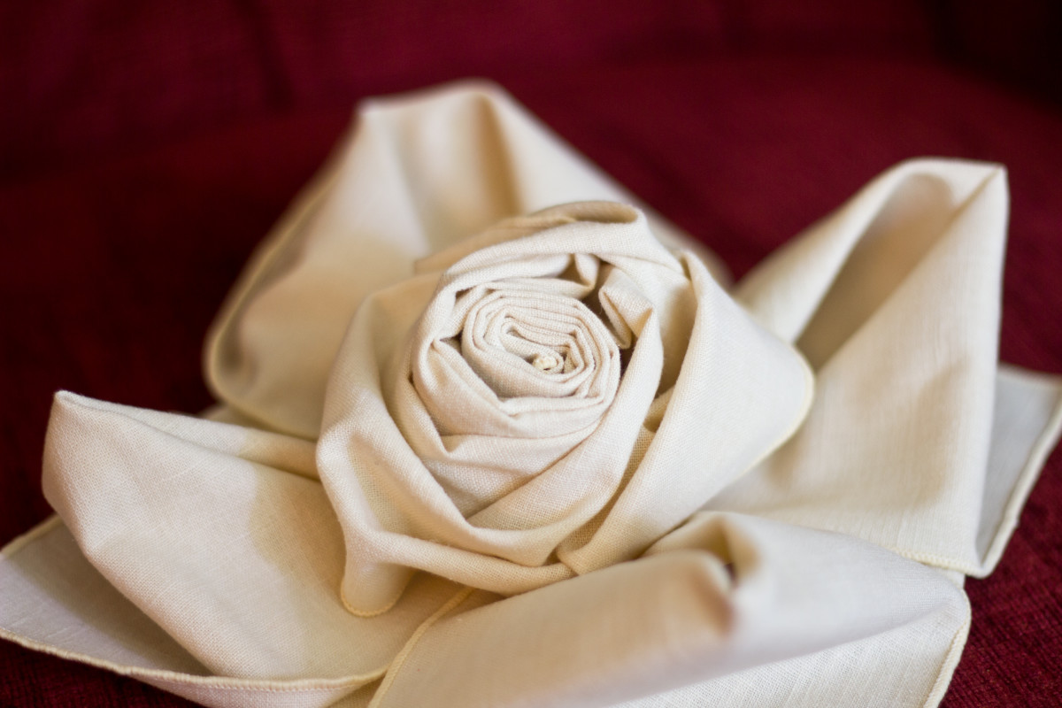 A rose placed in the center of the waterlily fold.