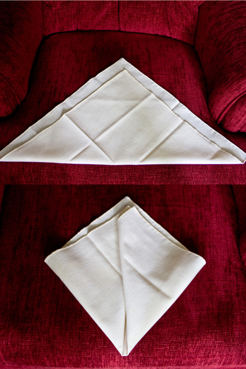 The first two steps of the classic napkin fold.