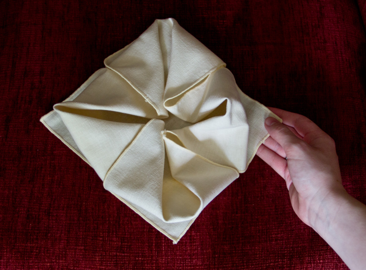 The final step in the waterlily napkin fold.