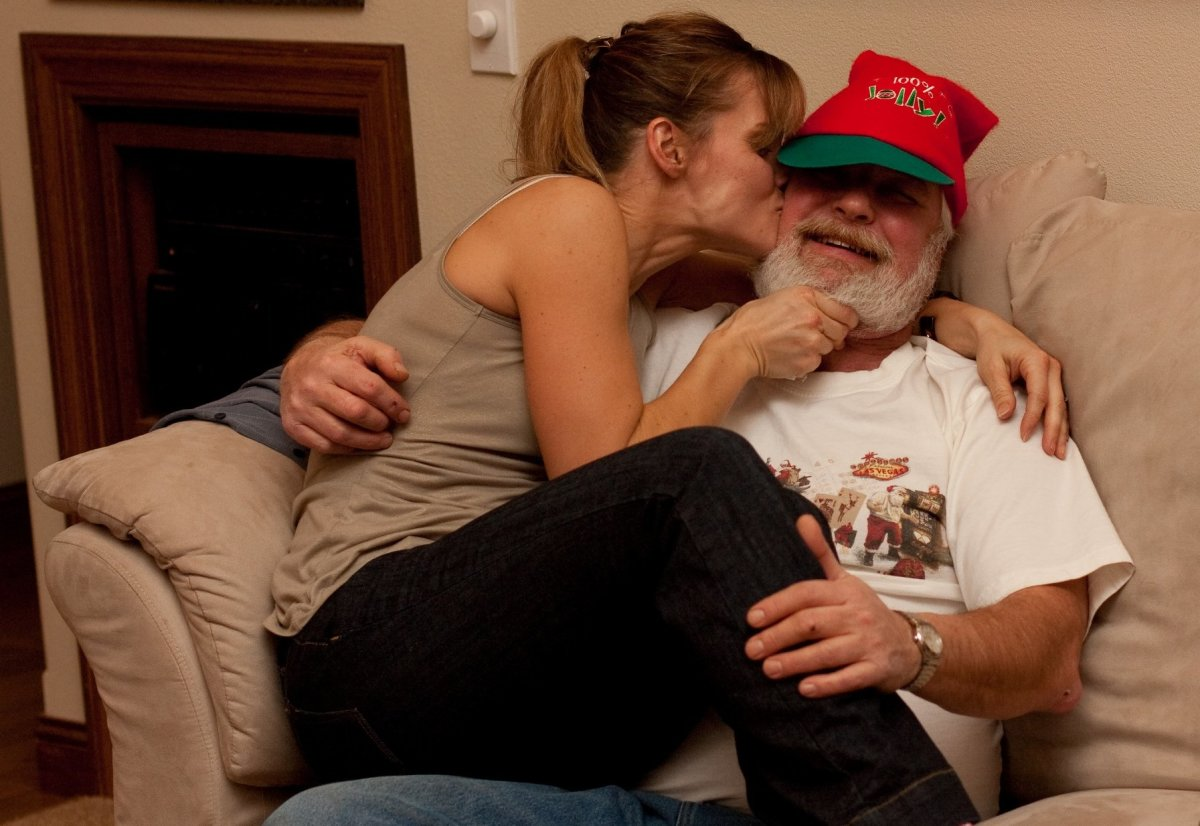 That doesn't look like Mrs. Claus to me, Santa! (Santa's not resisting too much.)