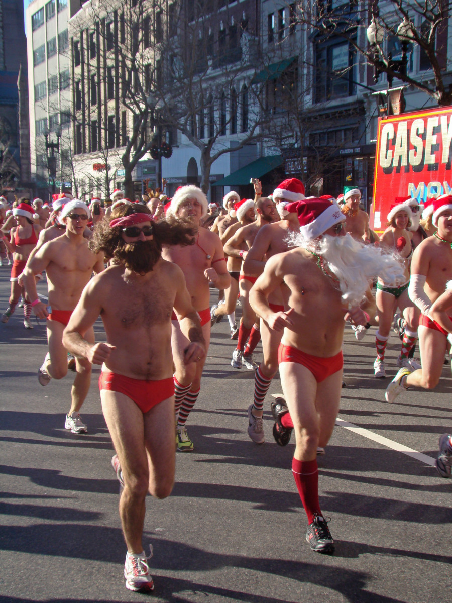 Jesus Santa (or Hippie Santa) meets regular Santa in the Santa Speedo Run in Boston.