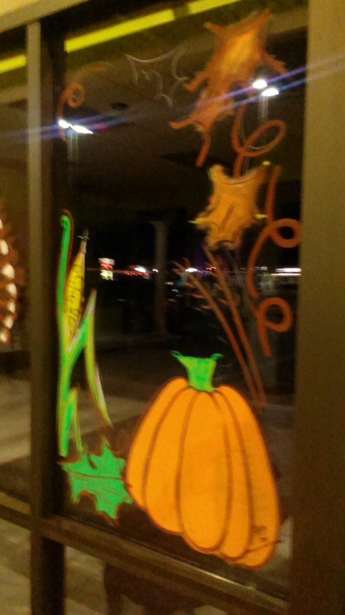 The final panel of the window scene - pumpkin images, leaf and corn accents