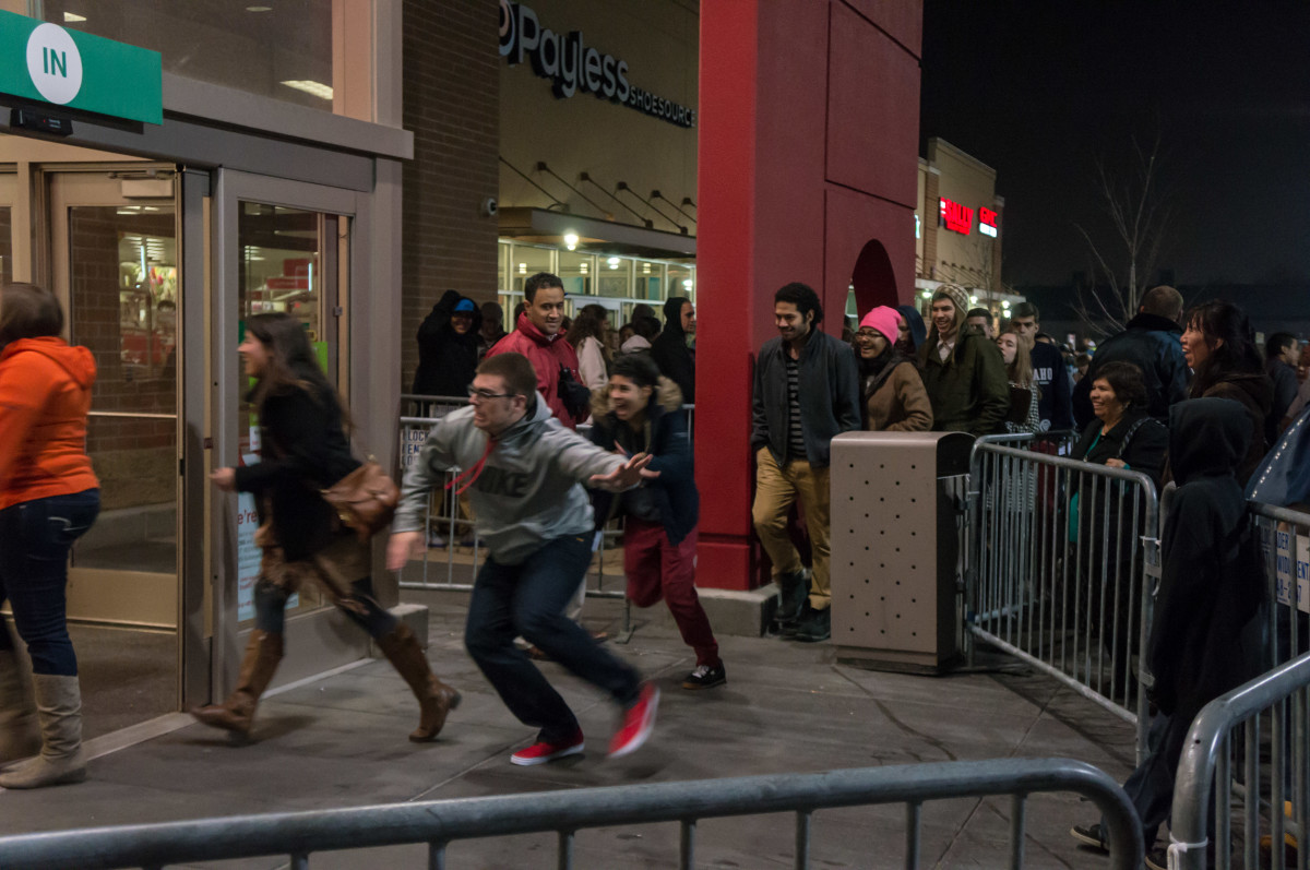 Frantic shoppers rush into their favorite stores to get the best deals of the season.