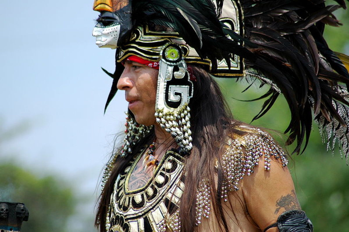 Aztec individual attending a pow wow.