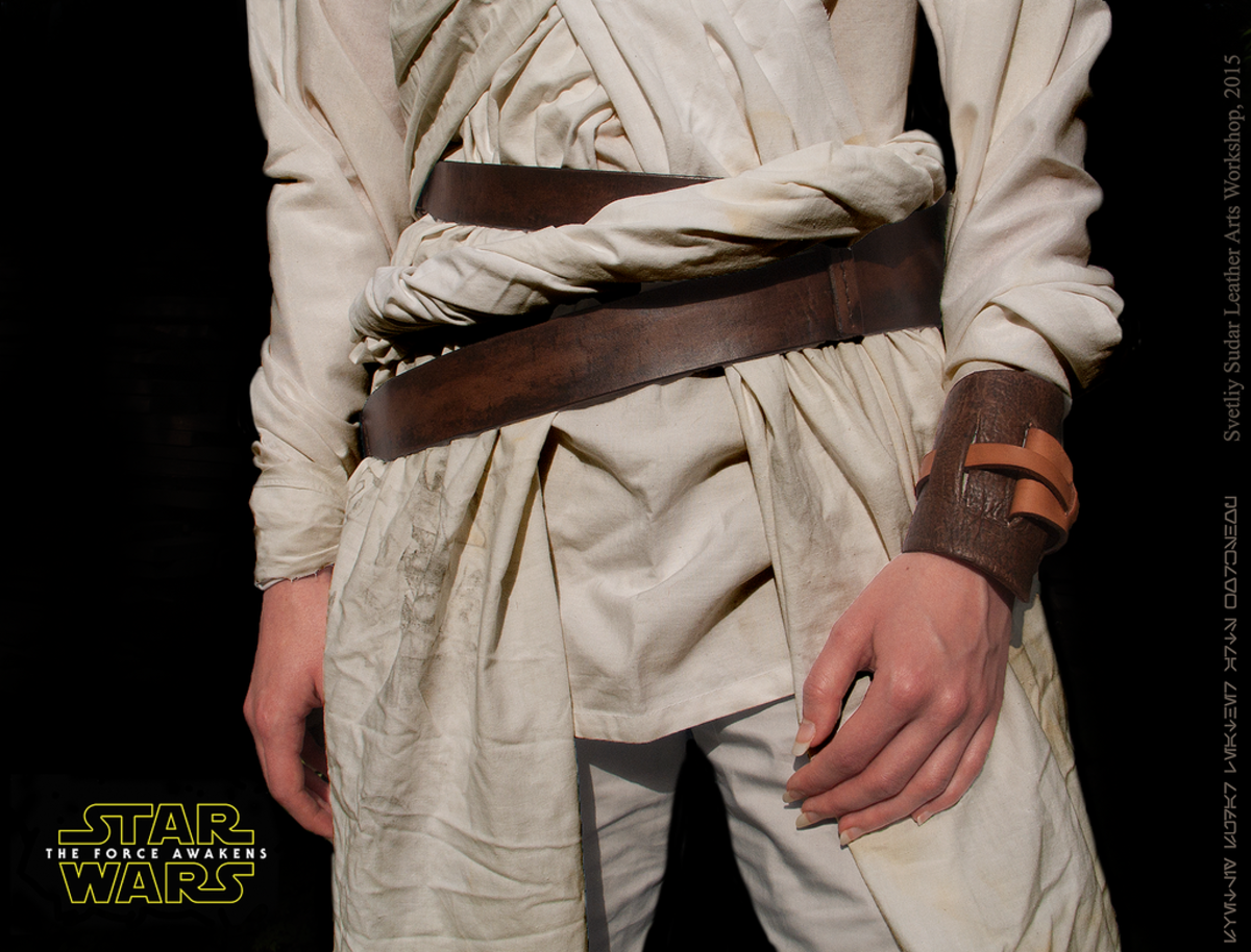 Close Up Of Rey's Wrist Band And Belts