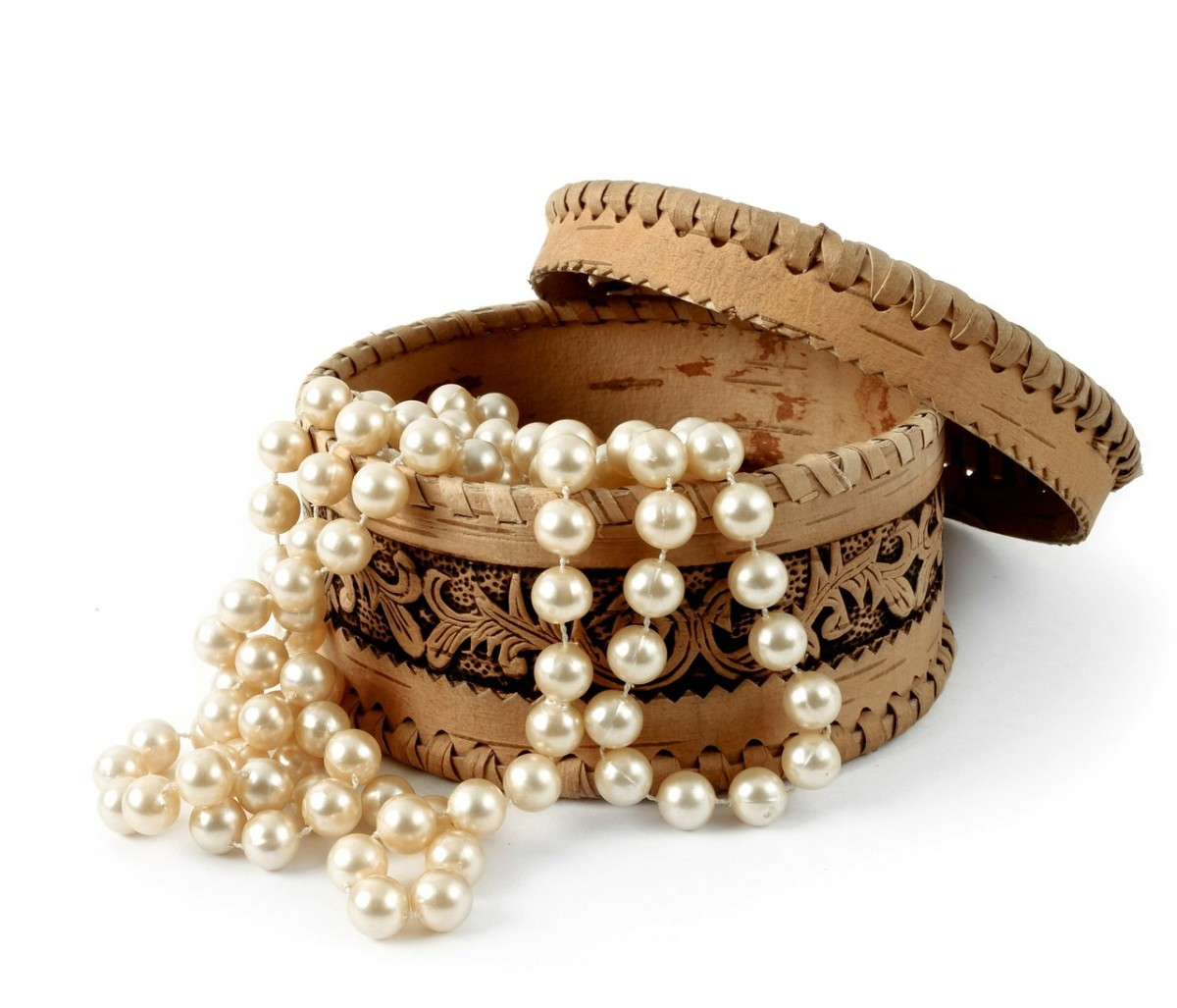 A string of faux pearls are lovely for a nice evening out, and you don't have to worry too much if they get lost or stolen on your trip.
