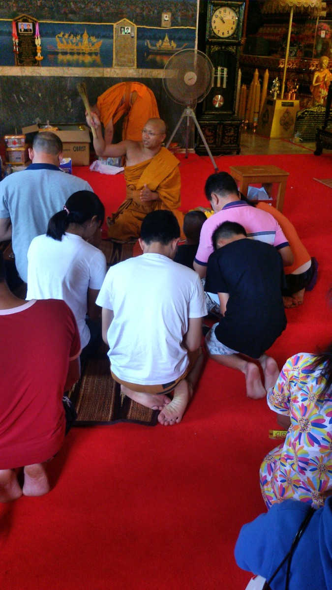 Getting a monk's blessing at a Buddhist temple