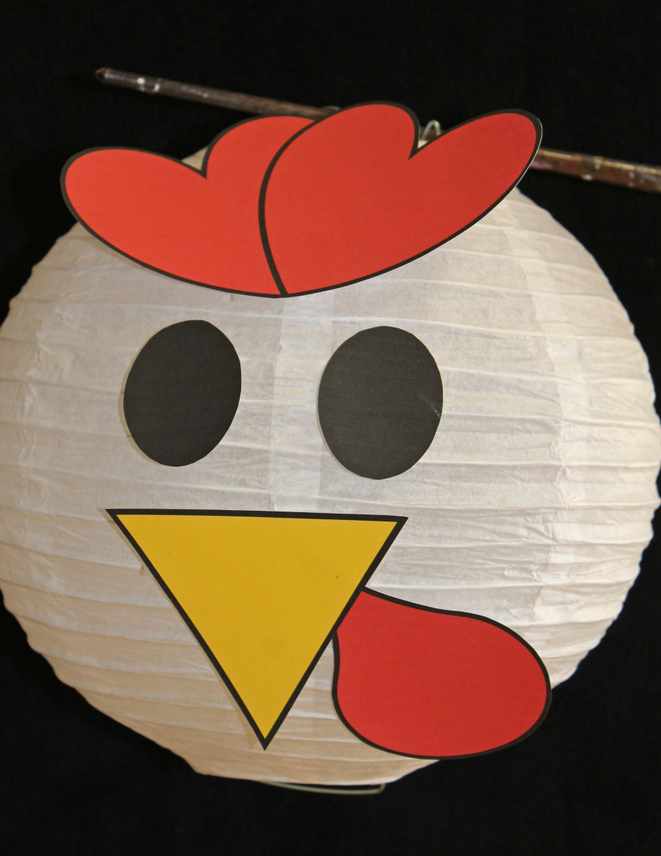 Here is a photo of a purchased paper lantern with rooster facial features. See the templates below that you can print, cut out, and attach to the lantern.
