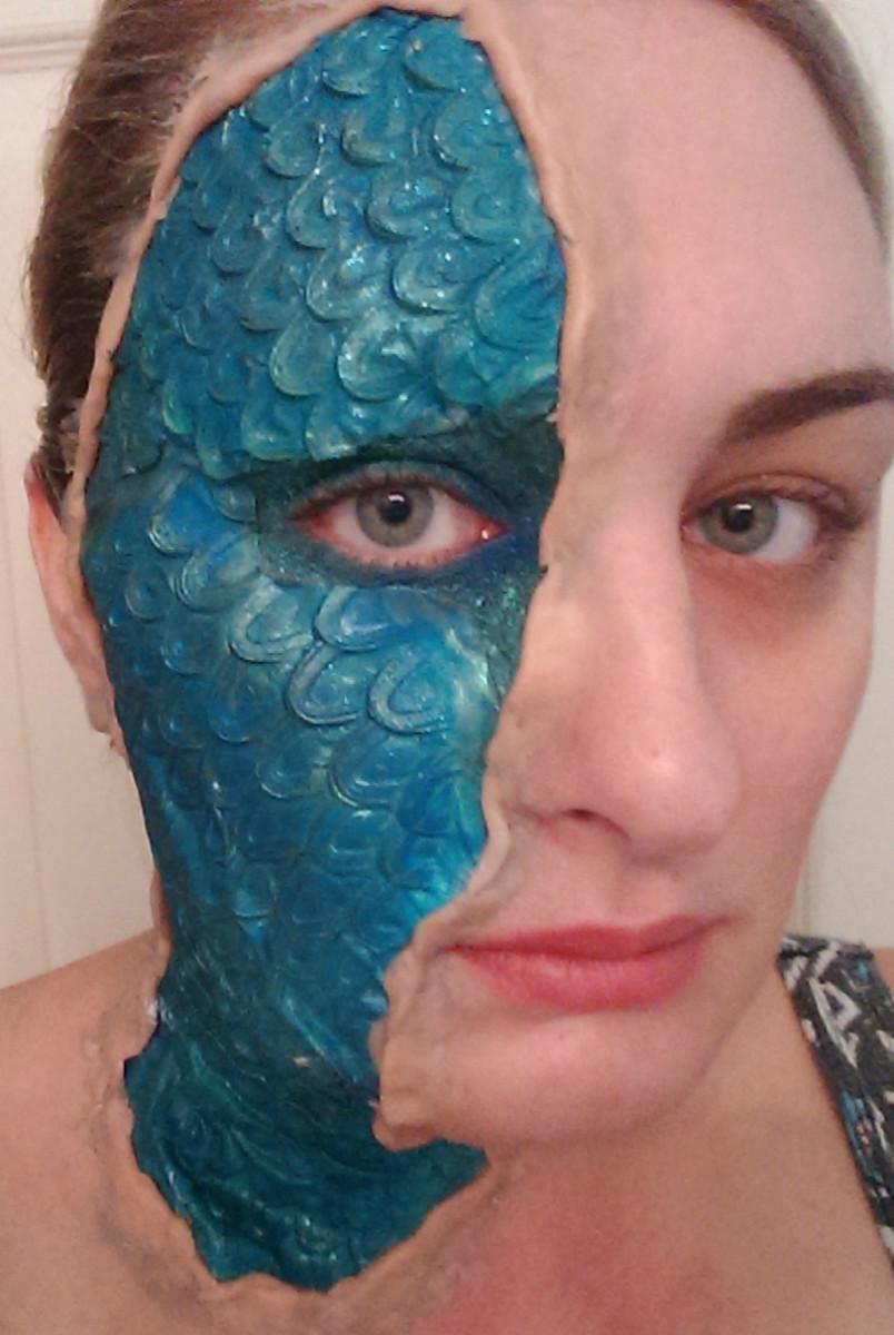 Before fake blood and finishing makeup, after applying fake skin!