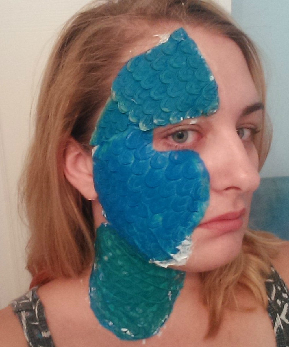 As you can see it looks pretty dumb when you first adhere the scales. don't be deterred - some makeup magic will help hide the individual pieces. Don't be afraid to cut your prosthetics to fit.