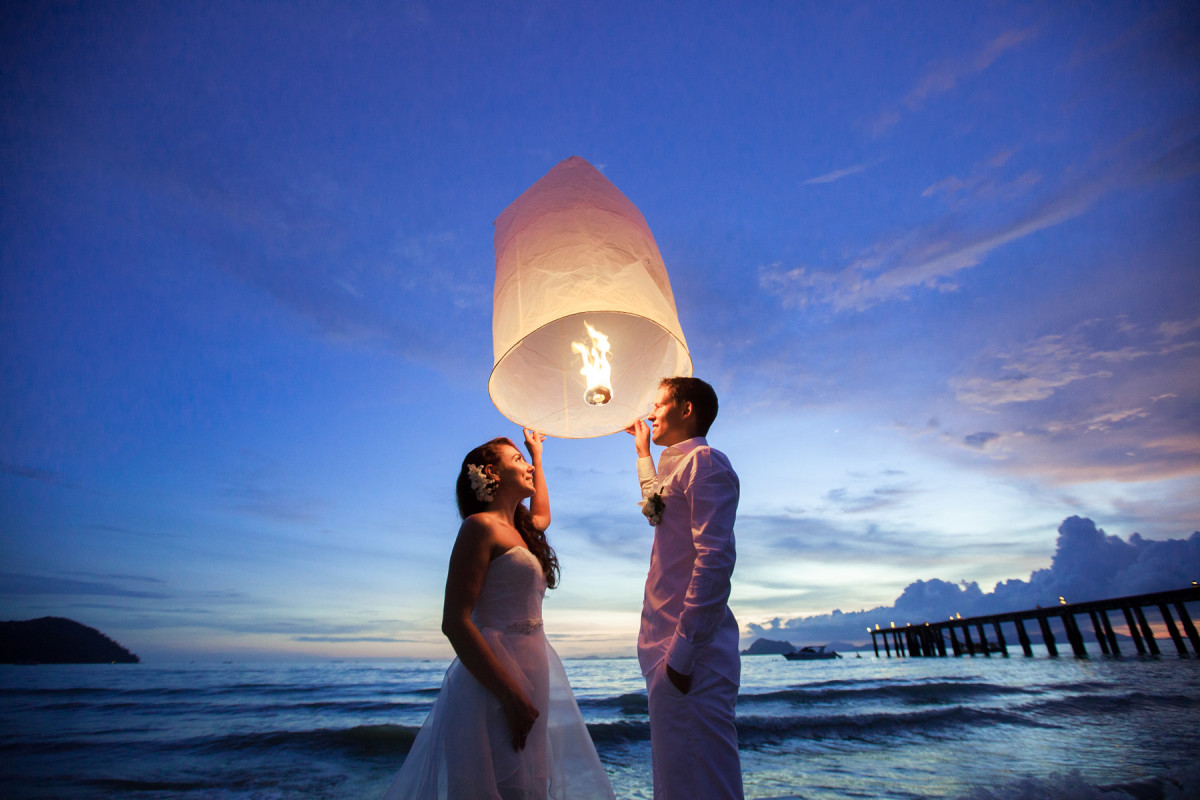 It is customary for newly weds to light a lantern together in Thailand...