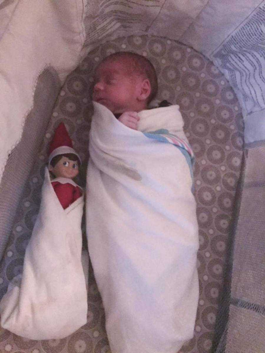 Swaddle the elf and your baby for a cute picture together!