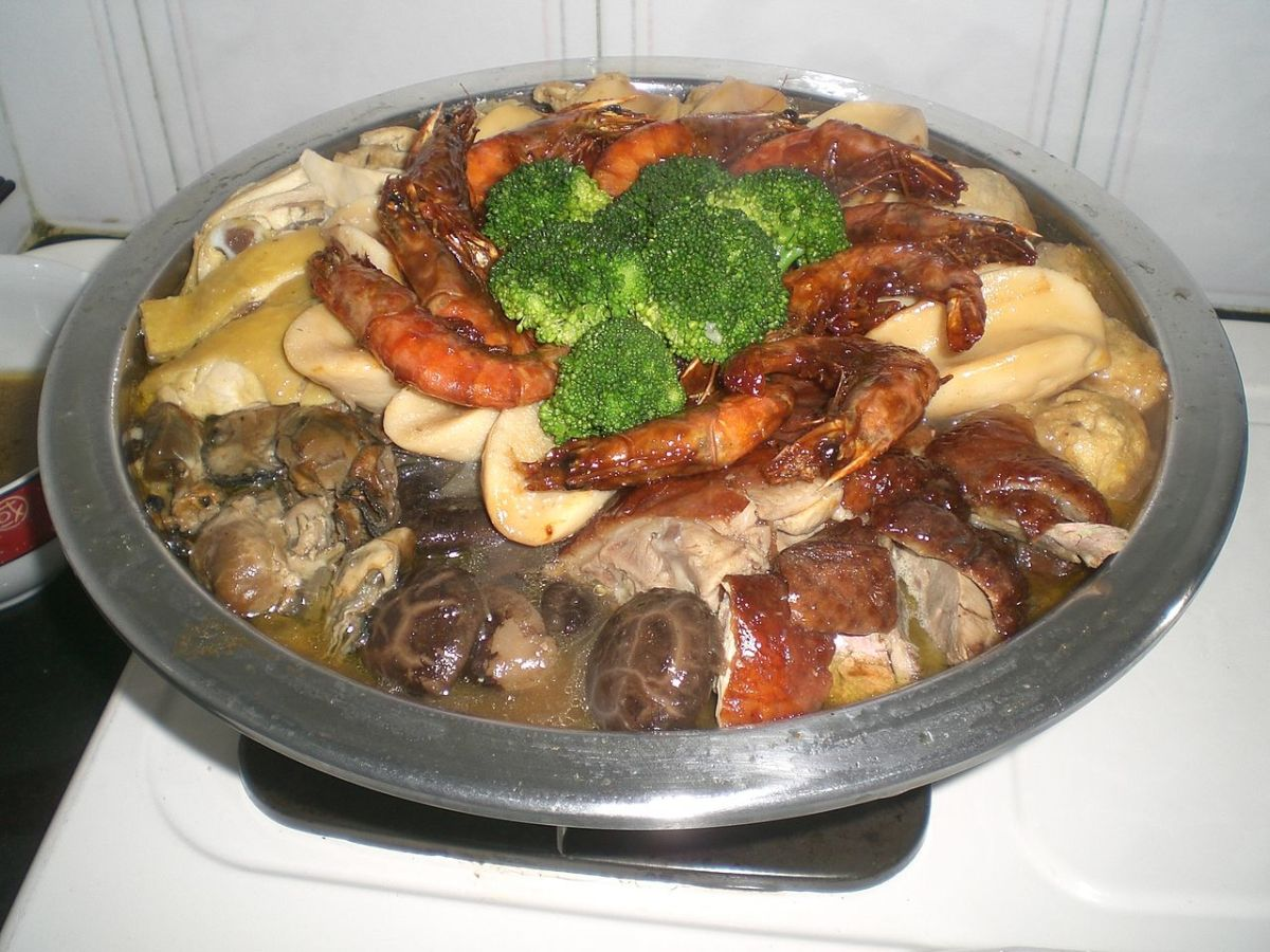 "Poon Choi, or Pen Cai, is another popular Reunion Dinner dish. It means ""big bowl feast,"" and contains different delicacies cooked in a thick stew."