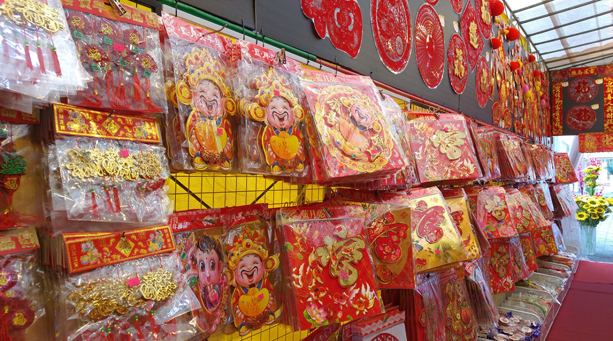 Cheerful Chinese gods of fortune, adorned with the Chinese character for fortune, are perpetually popular festive decorations..