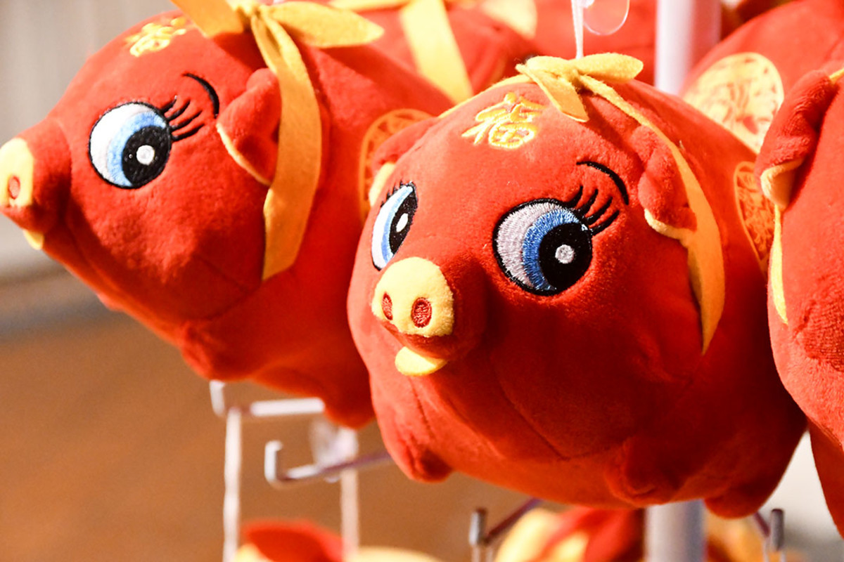 Decorations and toys featuring the incoming animal of the Chinese Zodiac are sold throughout the festive bazaar.