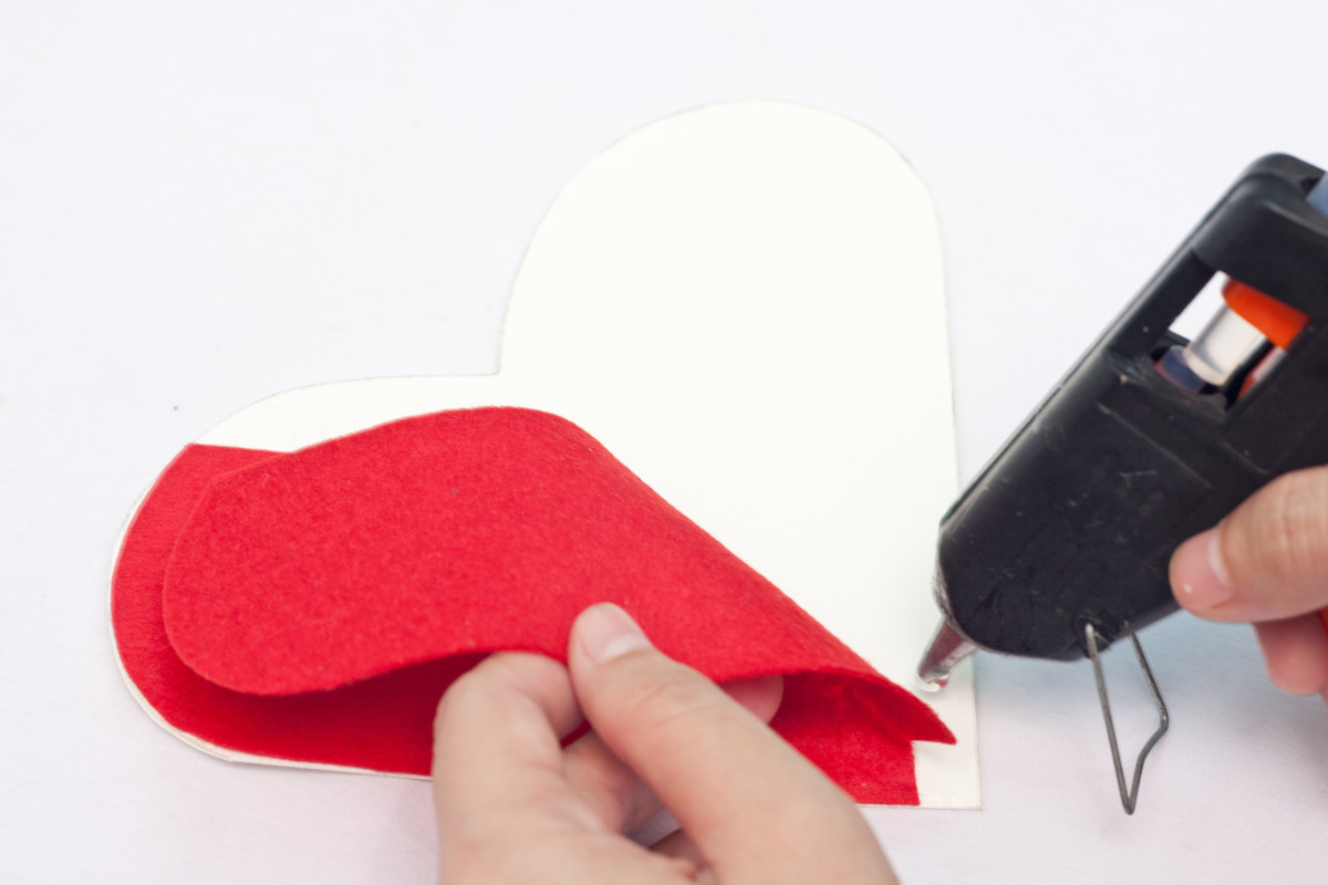 Hot glue the red felt to the cardstock heart