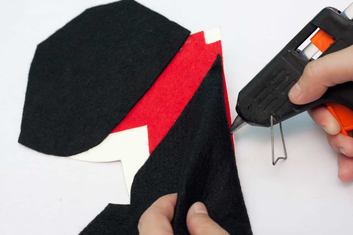 Line up the black felt and glue it into place to make your tux jacket