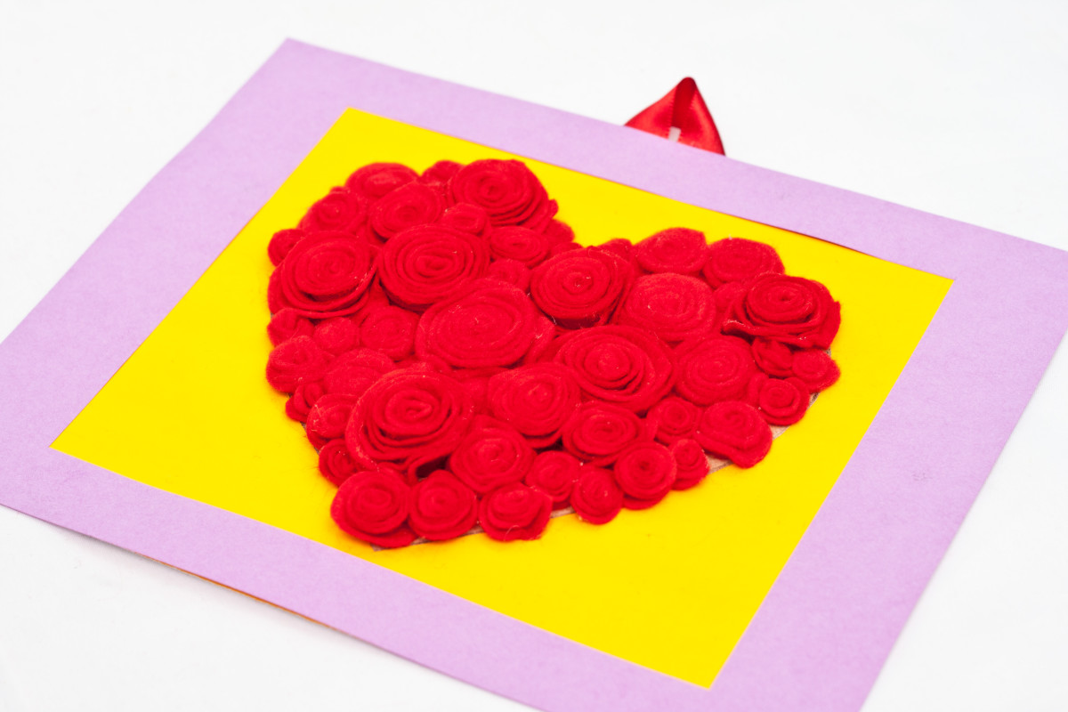 Step 13: Your heart shaped rose art is now ready to hang or be given away as a Valentine's Day gift. Now step back and take a look... your beautiful, homemade work of art is done!