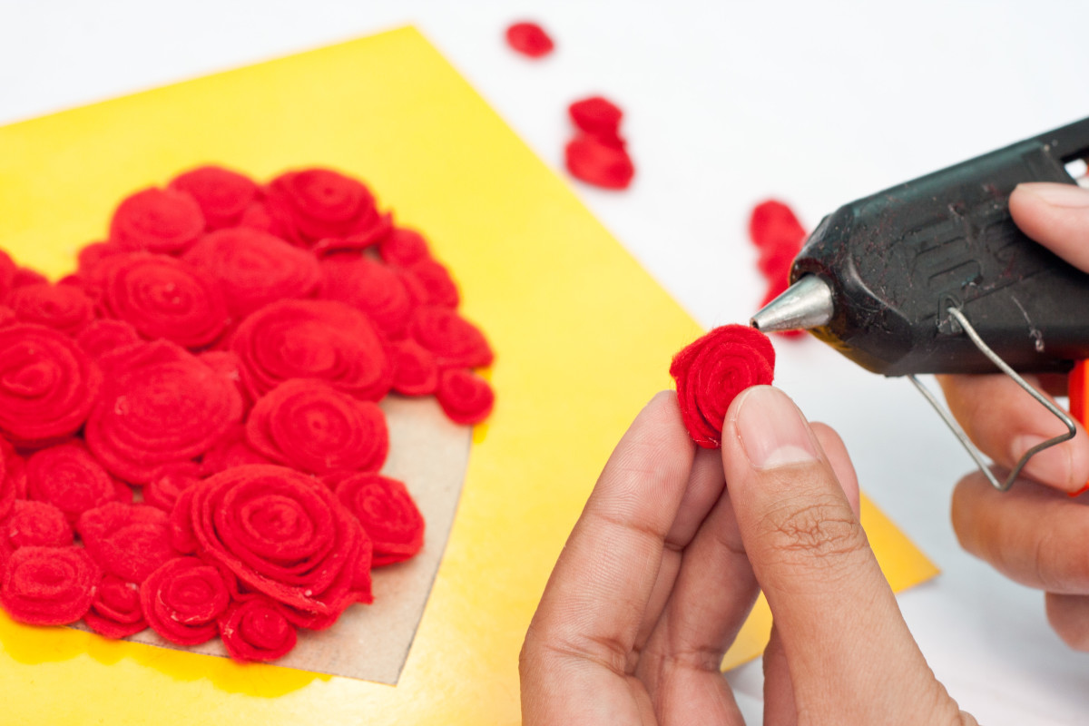 Step 8: Cover your heart pattern with the red roses and glue them into place with hot glue.  Shape them so they look like the roses in the picture
