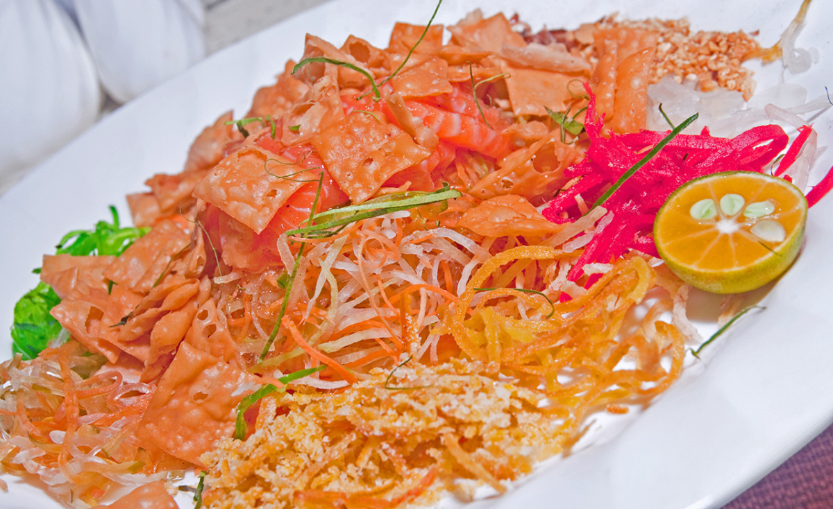 Yusheng, a classic raw fish dish eaten on the seventh day in Southeast Asia. There is, naturally, a Chinese New Year legend associated with this practice.