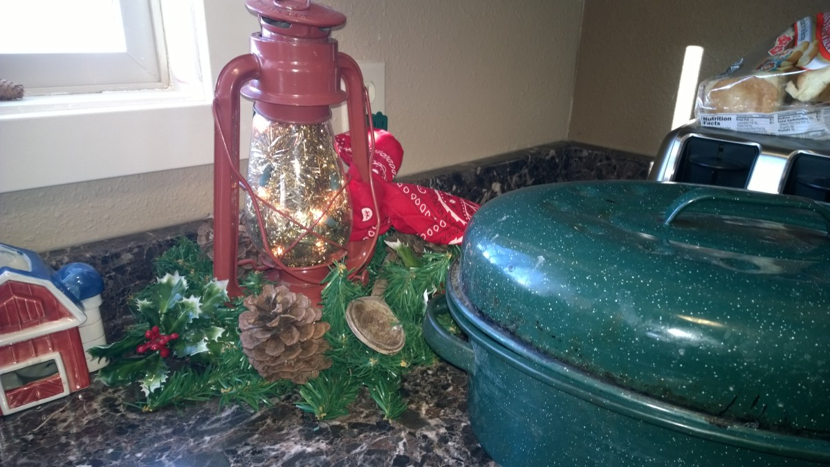This old red lantern was cleaned up and dressed with garland, pine cones, a red bandanna, and filled with a short string of warm Christmas lights.