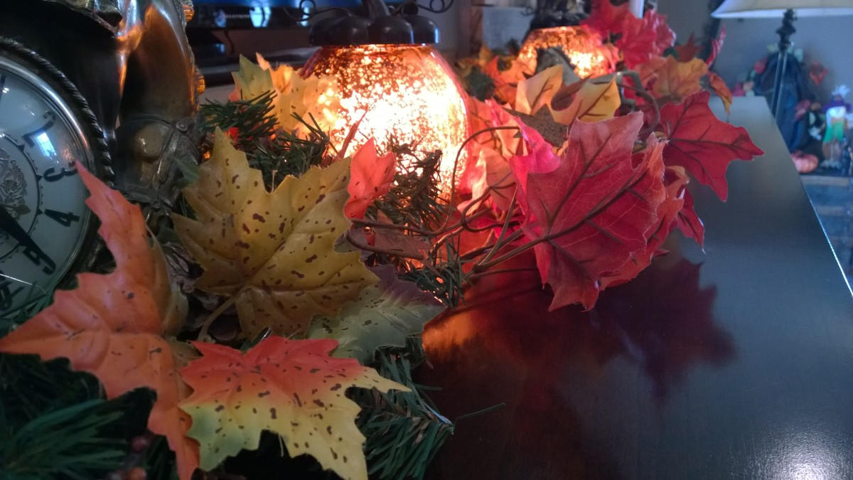 This brightly colored fall garland and light glob easily blends with Christmas decor later on.