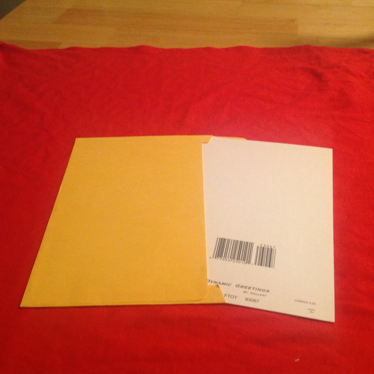 The wrong way to put a folded greeting card in its envelope