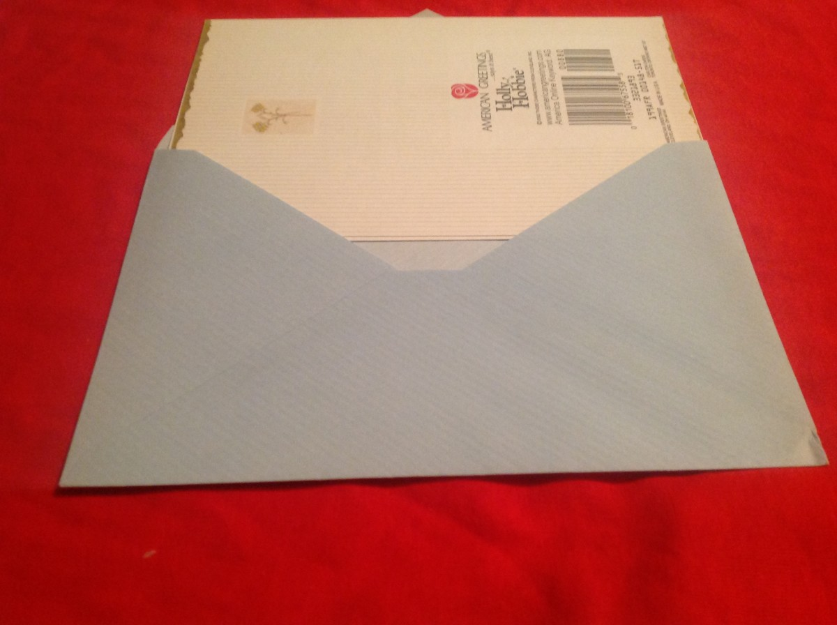 Example one: Is this the right way to put a folded greeting card in its envelope?