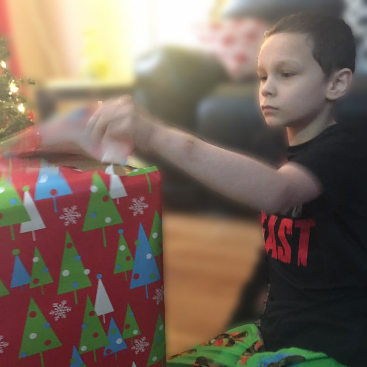 The struggle to open a present with autism