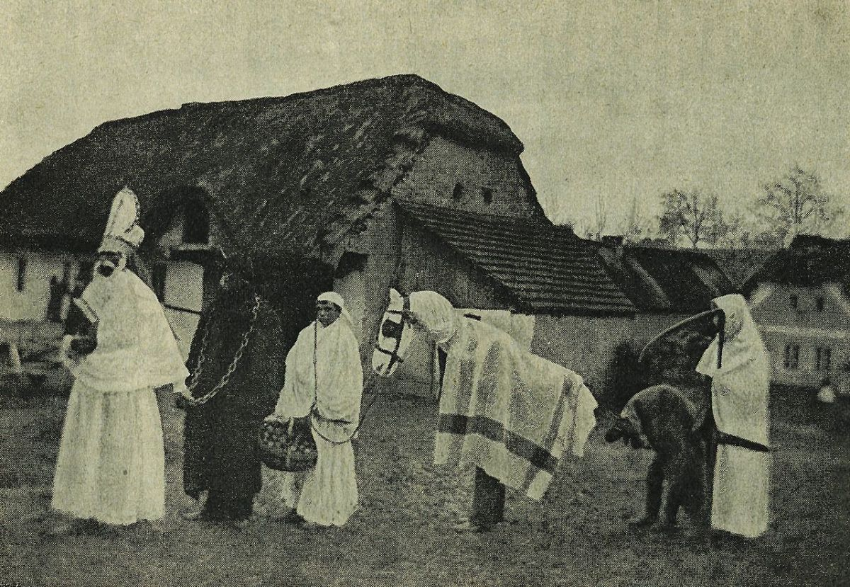 St. Nicholas procession with Krampus, and other characters, c. 1910, public domain