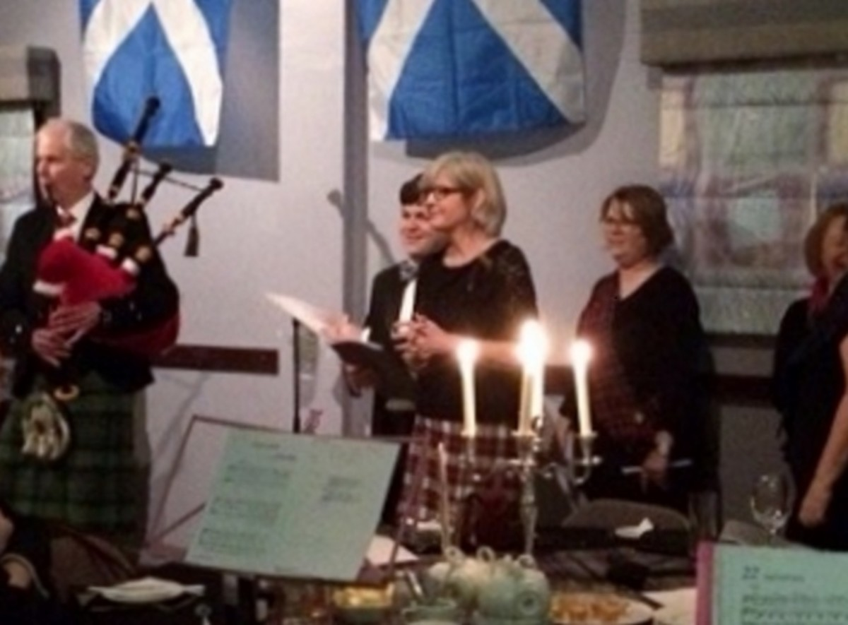 A Village Voices choir singing a selection of Robbie Burns songs at a Burns' Night supper 2018