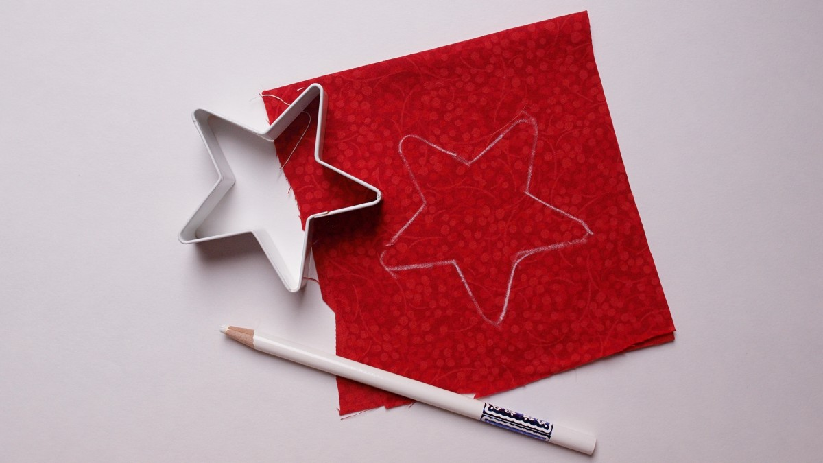 Trace the star shape on pressed fabric.