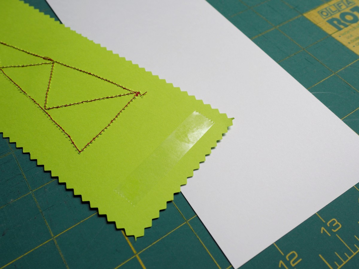 Add tape to back of colored card stock.