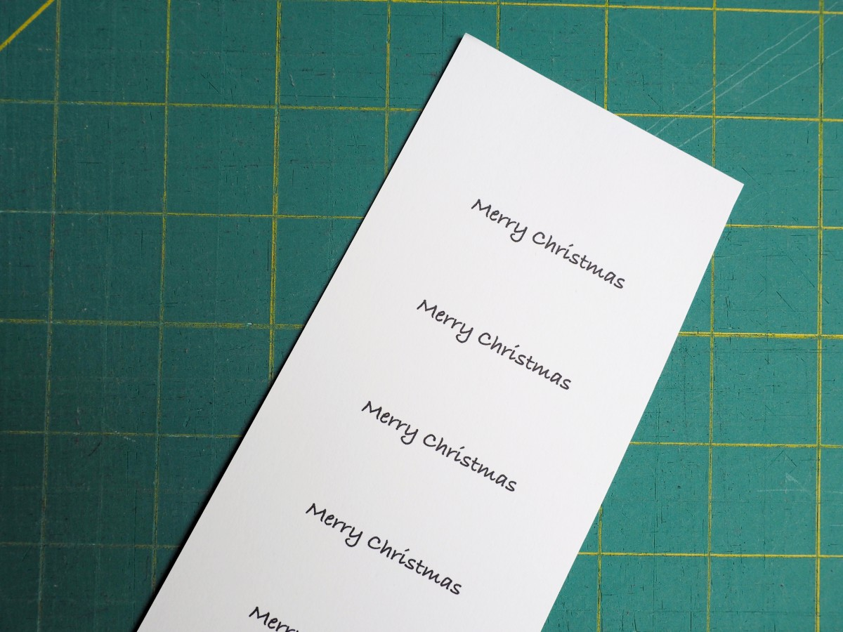 Print out your Christmas message on card stock.