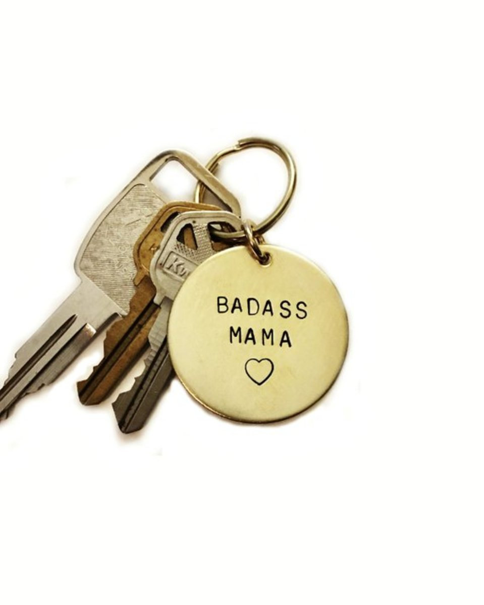 This Badass Mama key chain in gold brass or silver aluminum is great for feminist, liberal moms.