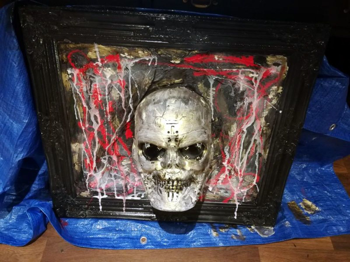 This is my completed blood-soaked Halloween skull display.