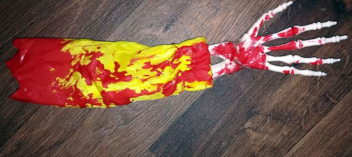 """The skeleton arm and raincoat sleeve I used in my Georgie decoration after adding """"blood"""""""