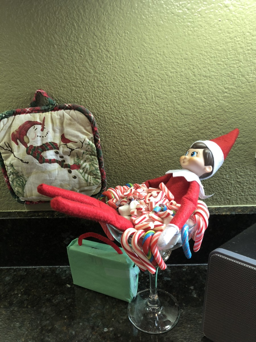 Our elf has arrived! With suitcase in tow and a bath of candy canes, our elf has arrived for the Christmas season. (This was from last year)