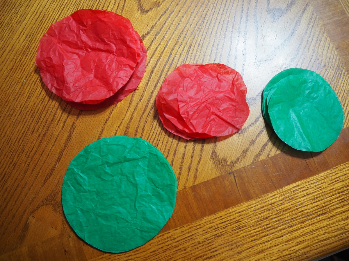 Cut your folded thicknesses of tissue paper into circles as you have traced them